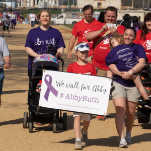 Group walking with sign for Abby Ruth