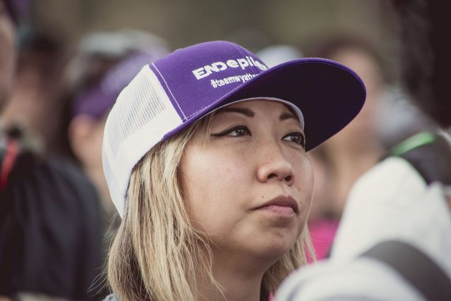 Woman looking pensive with End Epilepsy hat during walk