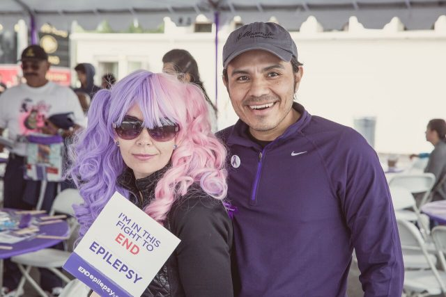 Couple dressed in purple with purple hair at walk rally